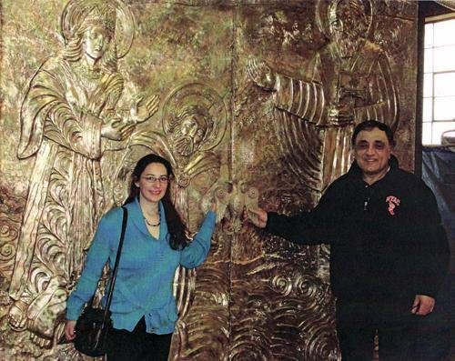 Deanna Yildiz is in a photo with Setrak Agonian, the man who hired her to design the bronze doors that they are standing in front of.